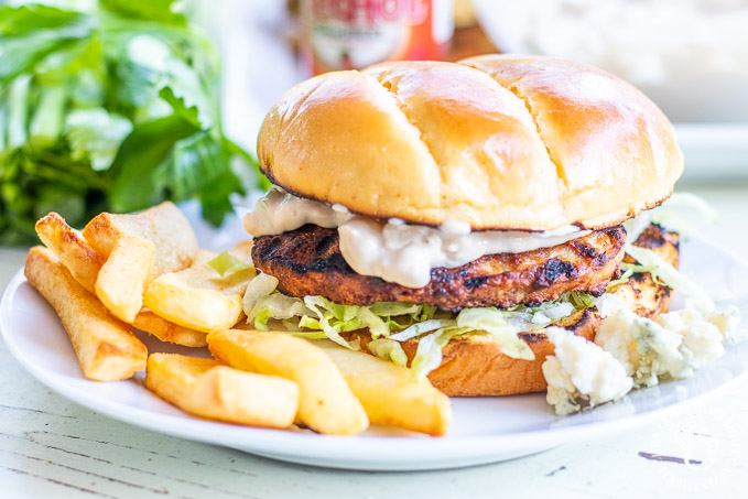 These tangy, tasty buffalo chicken burgers are a serious taste explosion – just make sure you've got enough blue cheese mayo to go around!
