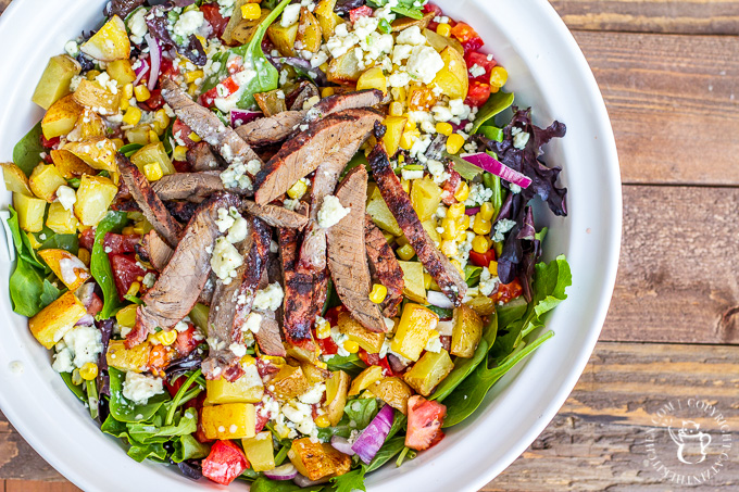 This is not your typical salad. It's got blue cheese. It's got potatoes. It's go steak. If you want a hearty, tasty dinner...cowboy steak salad!