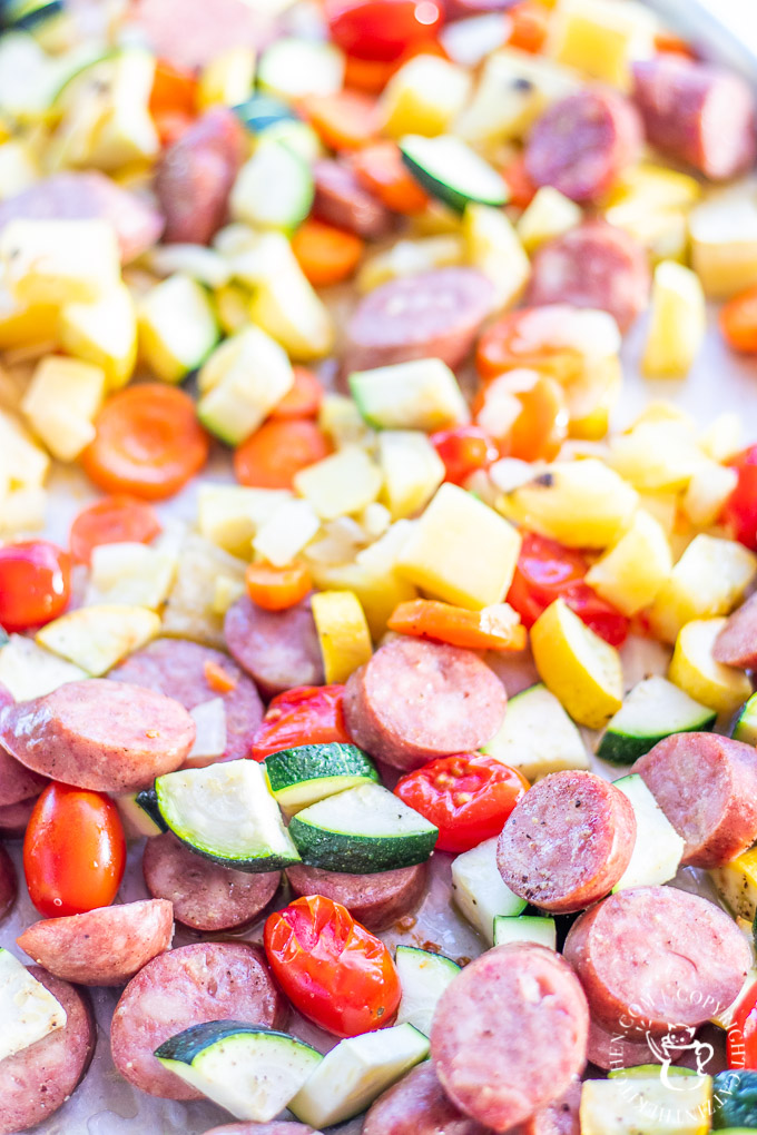 This one pan sausage dinner recipe includes lots of bright, flavorful, and healthy summer vegetables, and it's easy to prepare - just chop those veggies!
