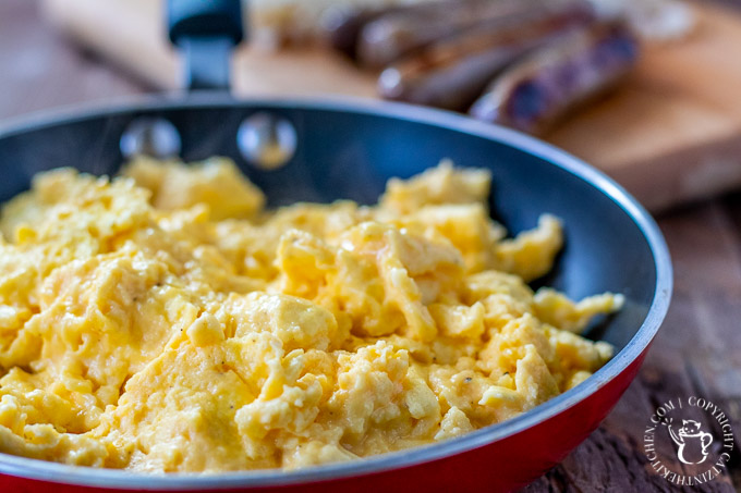 This incredibly simple four-ingredient recipe results in the best cheesy scrambled eggs we know how to make! Breakfast, brunch, or breakfast for dinner!