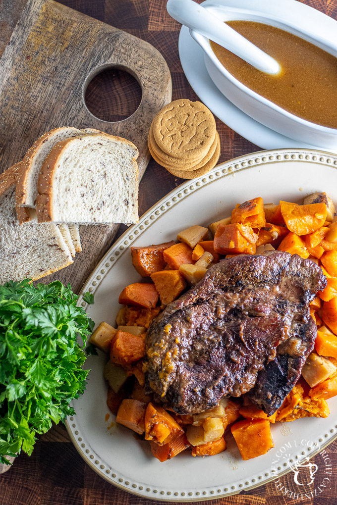 Slow Cooker Gingersnap Pot Roast with rye bread and vegetables